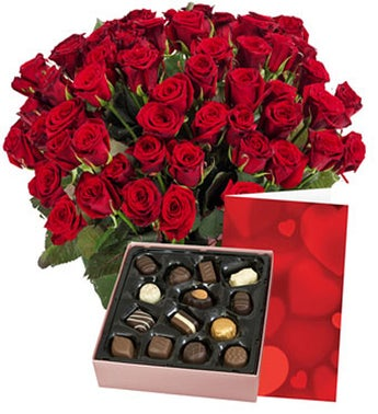 Red roses  chocolate and card